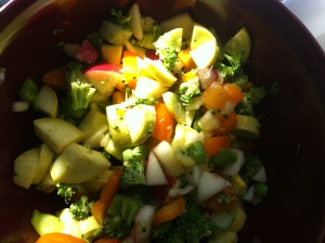 Washed, chopped organic yellow squash, broccoli, orange pepper, & gala apple in juice from fresh lemon and lime...